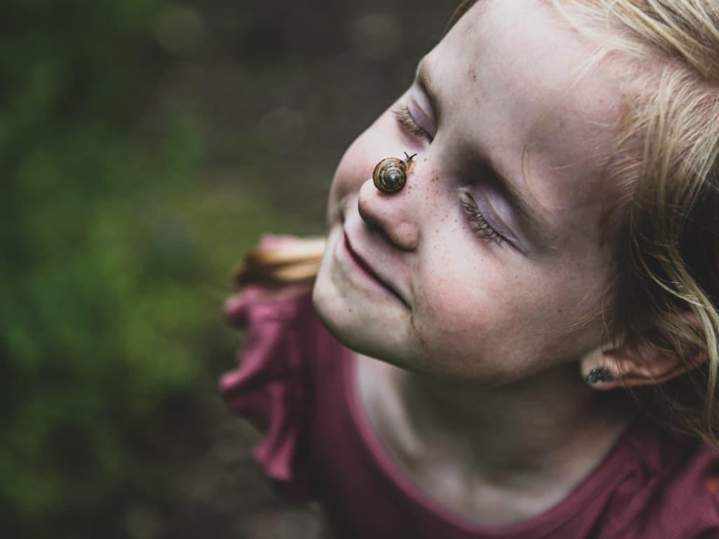 Fotos von pann- - Kind mit Schnecke